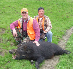 two hunters and a black hog