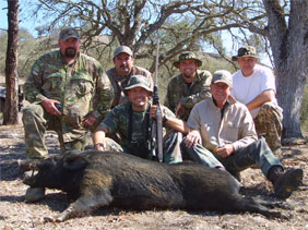 group of hunters with hog